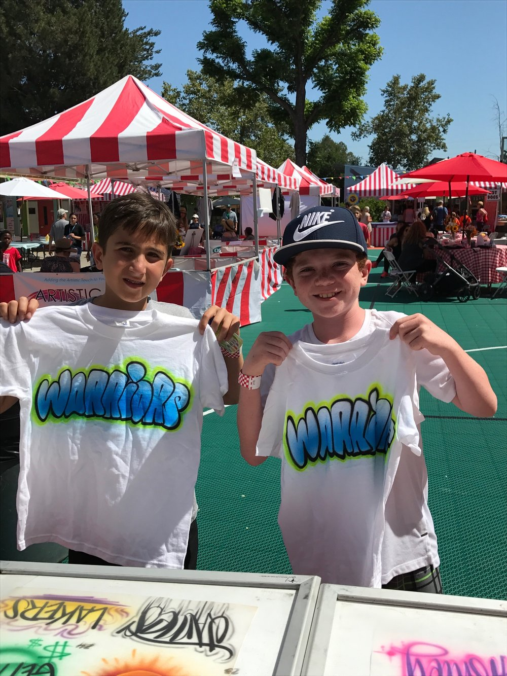 Airbrush t-shirts at a school carnival