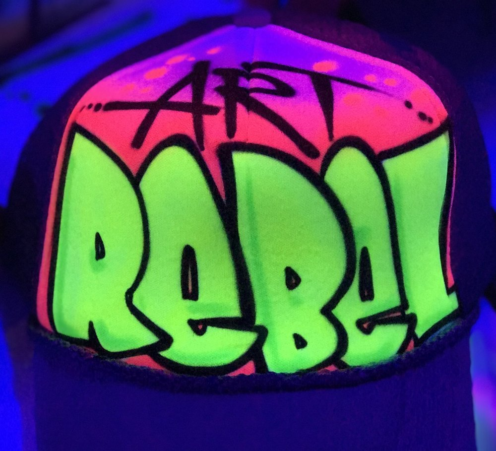 Art Rebel airbrushed trucker hat
