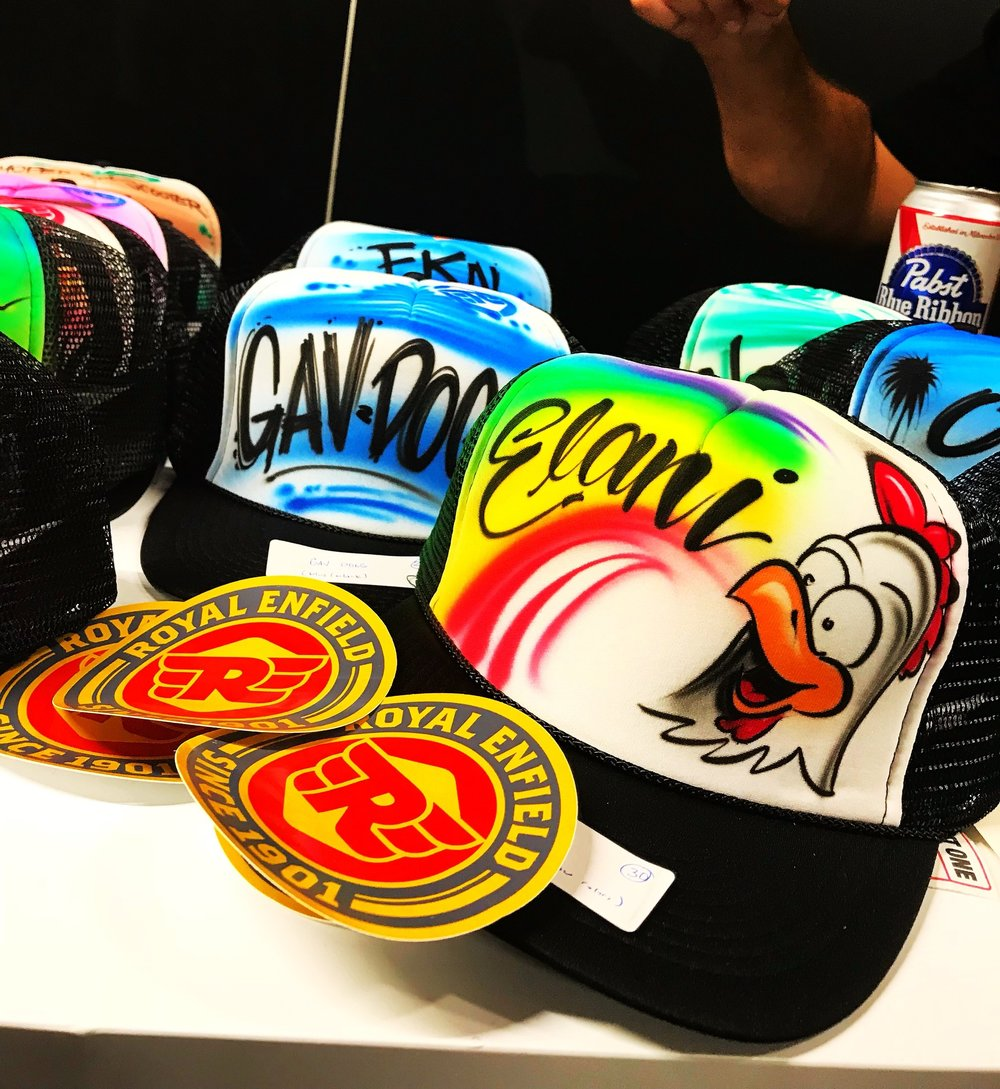 Custom airbrushed trucker hat Multi hat display Royal Enfield