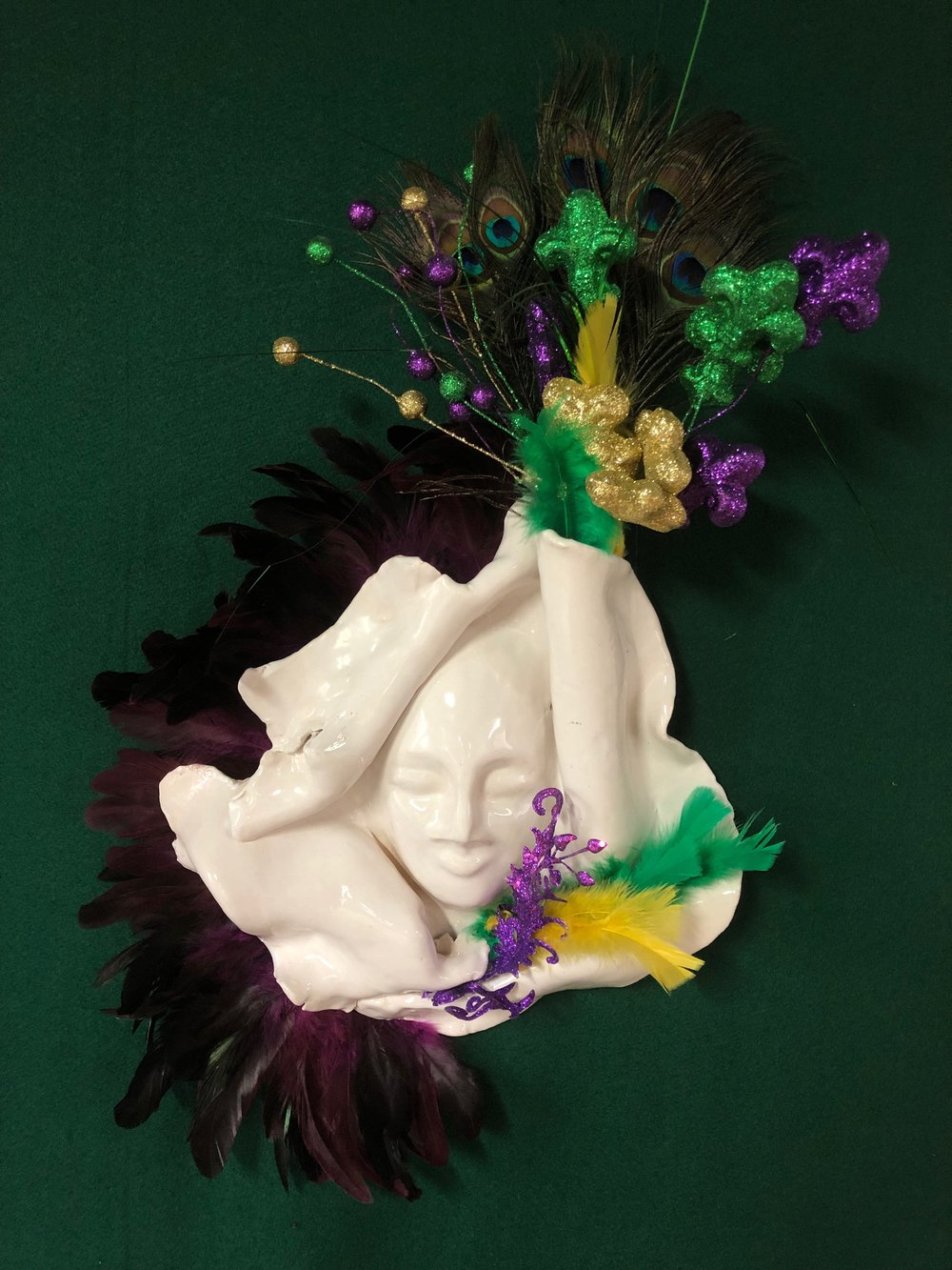 Image shows an Adrienne Walker mask that you will be working with, approximately 8x10inches in size. *this mask shows an example of how you can decorate and embellish the piece to make it your own.