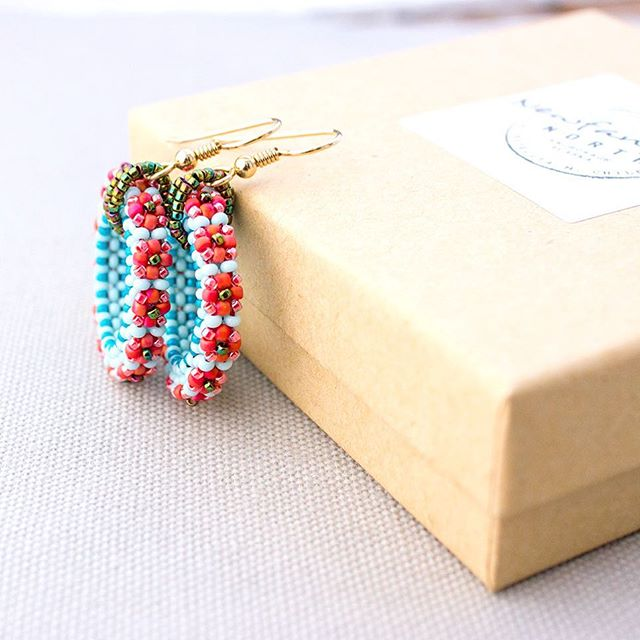 Little. Beaded. Flowers.  #ForgetMeNot #NewfangledNorth #flowerjewelry #redandblue #madeinalaska #alaska #beadwork #beads #hoops #beadobsession #beadtexture #cubicrightangleweave #tinydetails