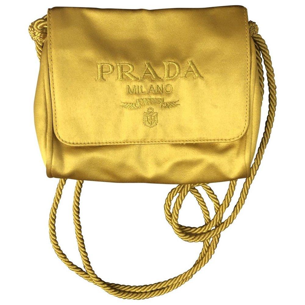 6. Prada - Silk Clutch Bag VINTAGE (Vestiaire Collective) - Image source and bag: here.