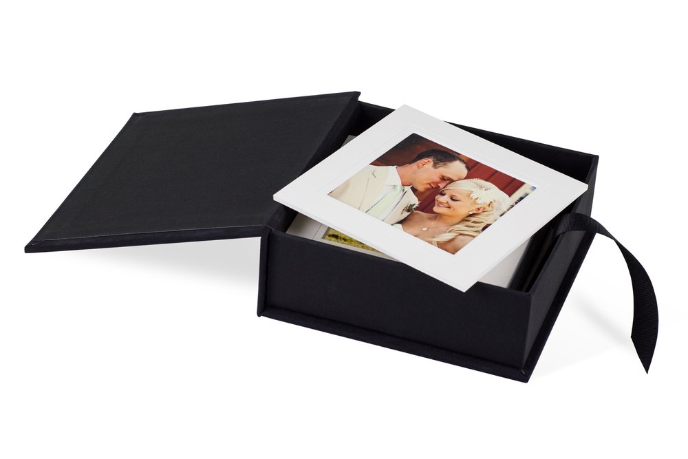 Custom Photo Boxes - Choose lustre or matte paper prints or highlight your favorite images in mat board (white or black) and store them inside your custom photo box. Comes with easel so you can easily display images and change them in and out as often as you wish. Custom photo boxes hold between 100 to 400 premium prints, less if you choose prints mounted on 3mm mat board or styrene. Prices start at $300.