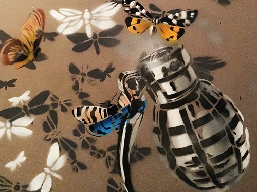 Hand+grenade+with+butterfly+mural.jpg