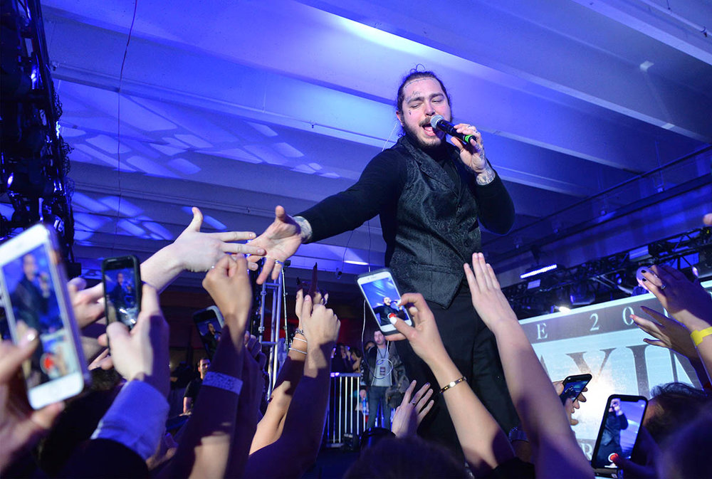 Post Malone takes the stage at the 2018 Maxim Super Bowl Party