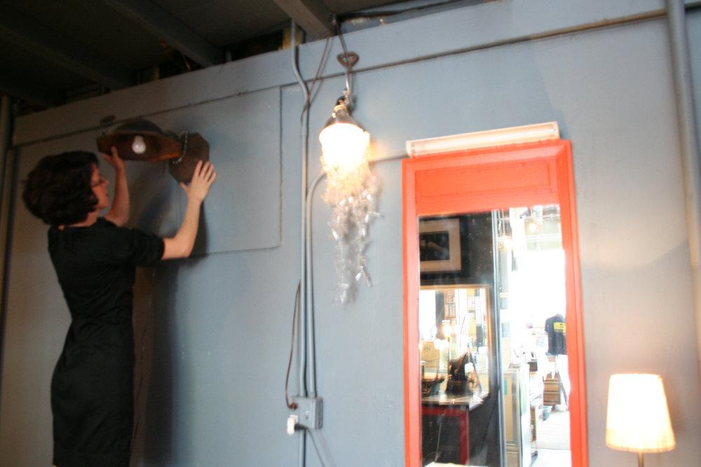 Rani hanging a lamp