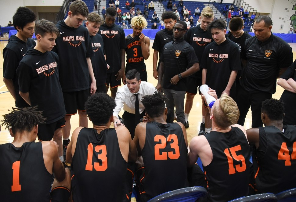 (Francisco Kjolseth | The Salt Lake Tribune) Wasatch Academy head coach David Evans gathers his team during a time out.