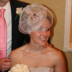 Congratulations to Anne and her husband on their wedding day. To complement her gorgeous dress, Anne wore one of my PLUME designs, featuring a light chocolate shot satin base, crin trim with handmade chiffon petals and ostrich feather centrepiece.