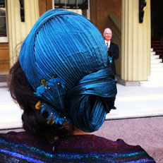 A big thank you to Terri who sent in this picture of her husband's investiture at Buckingham Palace. For this very special occasion, Terri chose a limited edition version of my TURBAN headpiece in a deep turquoise pleated silk, embellished with tiny Lady Amherst pheasant feathers.