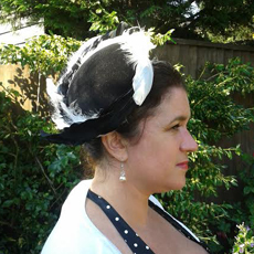 Suzanne wore a black velvet headpiece embellished with black and white goose feathers to Newmarket Races ladies day, adding the perfect touch to her beautiful vintage inspired outfit.