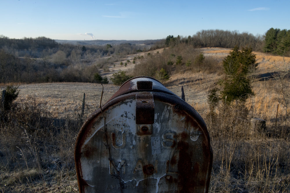 A mailbox on a ridge in Shade, Ohio sits at a vantage point looking Southeast towards the coal-fired American Electric Power Mountaineer Power Plant near New Haven, West Virginia. Shade is an unincorporated community that receives its power from the AEP Mountaineer Power Plant.