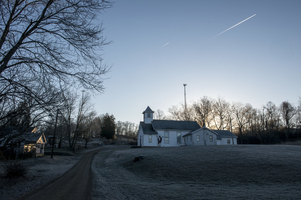 Jet streams streak across the sky above the Shade United Methodist Church.