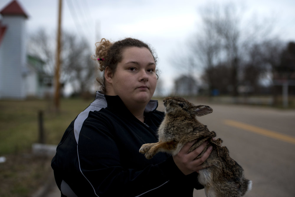 Nikki Stobart holds a dead rabbit she found on the side of the road after school one day.