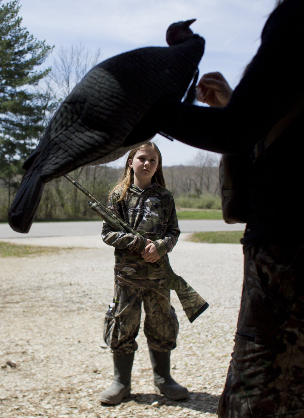 "Hunting guide Shannon Gillette held up a turkey decoy before taking Maris Drew of Jasper, 11, and her father Mike Drew out to hunt at the Youth Turkey Hunt at Patoka Lake, Ind. on April 21, 2018. Maris, who had never turkey hunted before, said her favorite part is ""that excitement that you get when you actually see that animal come out of the tree line."""