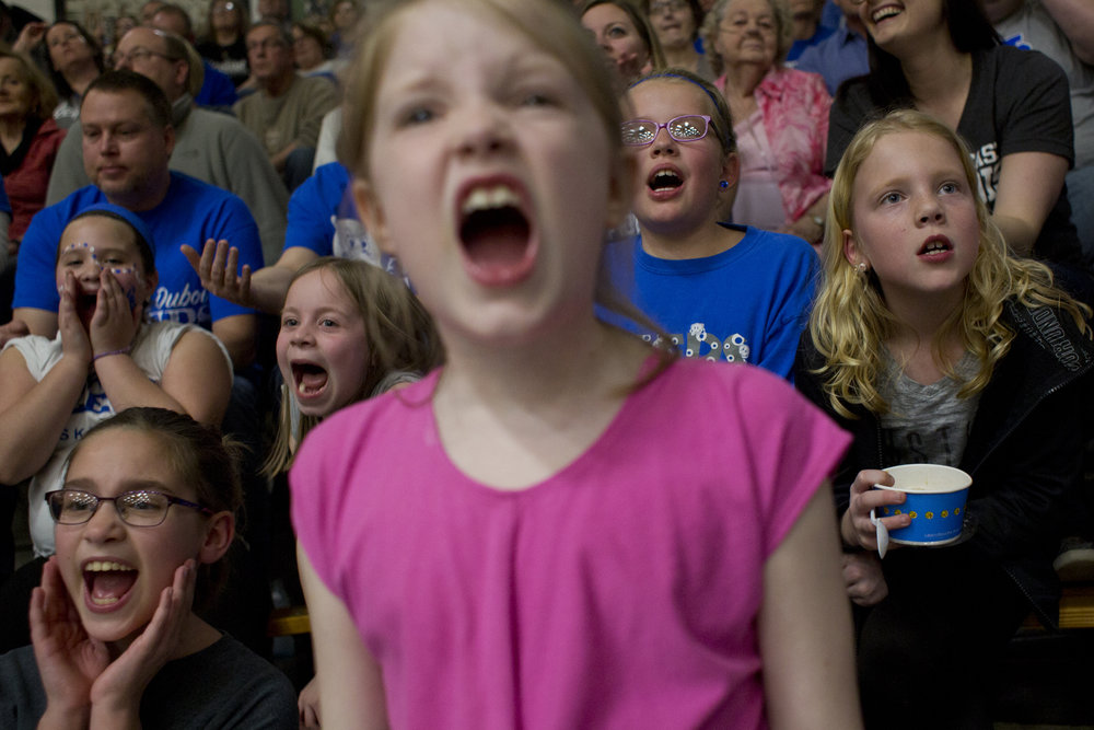 Emerson Kellams of French Lick, 8, right, Zoey Carr of Dubois, 8, center, and Claire Faulkner of Dubois, 8, left, cheered during the Jeeps' sectional final at Springs Valley High School in French Lick on Saturday. The Jeeps lost 68-54.