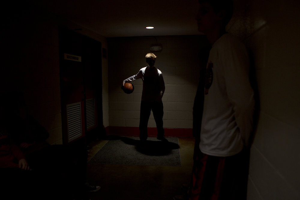"""Southridge High School's Joe LaGrange dribbled in the hallway before facing Sullivan High School at Huntingburg Memorial Gym in Huntingburg, Ind. on March 3, 2018. """"They're loose,"""" said coach Ted O'Brien. Southridge won 47-32, and went on to win the sectional title two days later."""