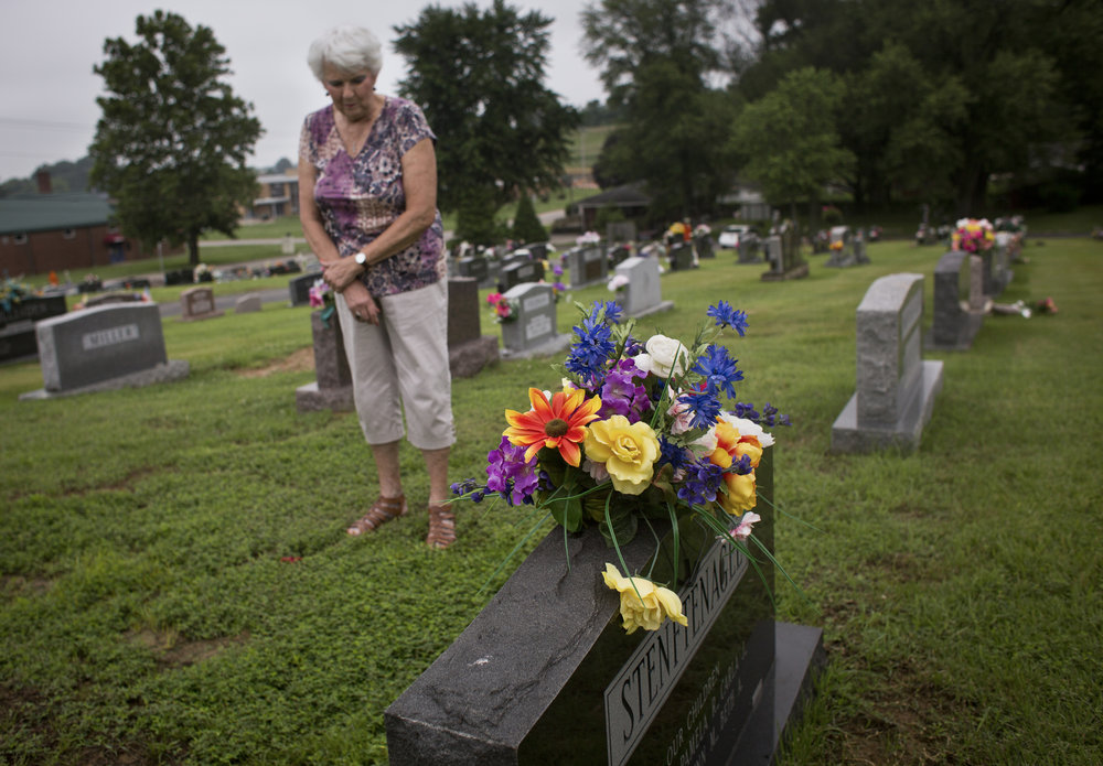 """When Marge visits her late husband, Si, at Fairview Cemetery, she often thinks about what they used to do together. """"I tell him he's in a better place,"""" she said. Marge said a prayer at Si's grave in Jasper on June 13, 2018."""