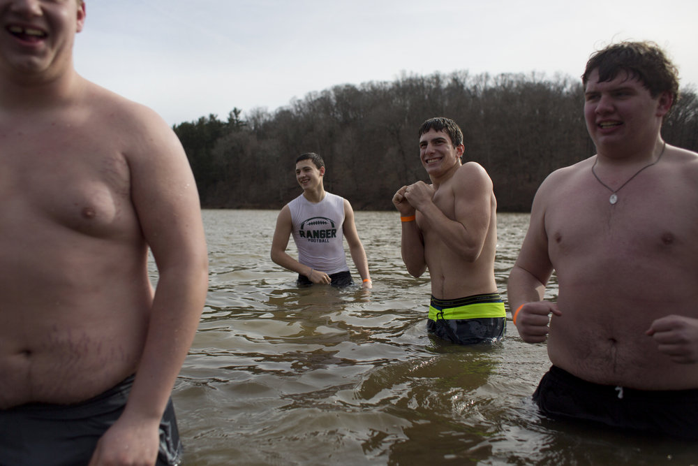 "Forest Park football players Zach Lueken of St. Anthony, 17, right, Garret Berg of Ferdinand, 16, Cory Uebelhor of Ferdinand, 15, and Brennan Weyer of Ferdinand, 16, held a contest to see who could stay in the 37-40-degree water the longest after the seventh annual polar plunge at the Ferdinand State Forest in Ferdinand on Sunday. Uebelhor won the contest and Berg placed second. ""As soon as I got in, my legs went numb,"" said Berg."