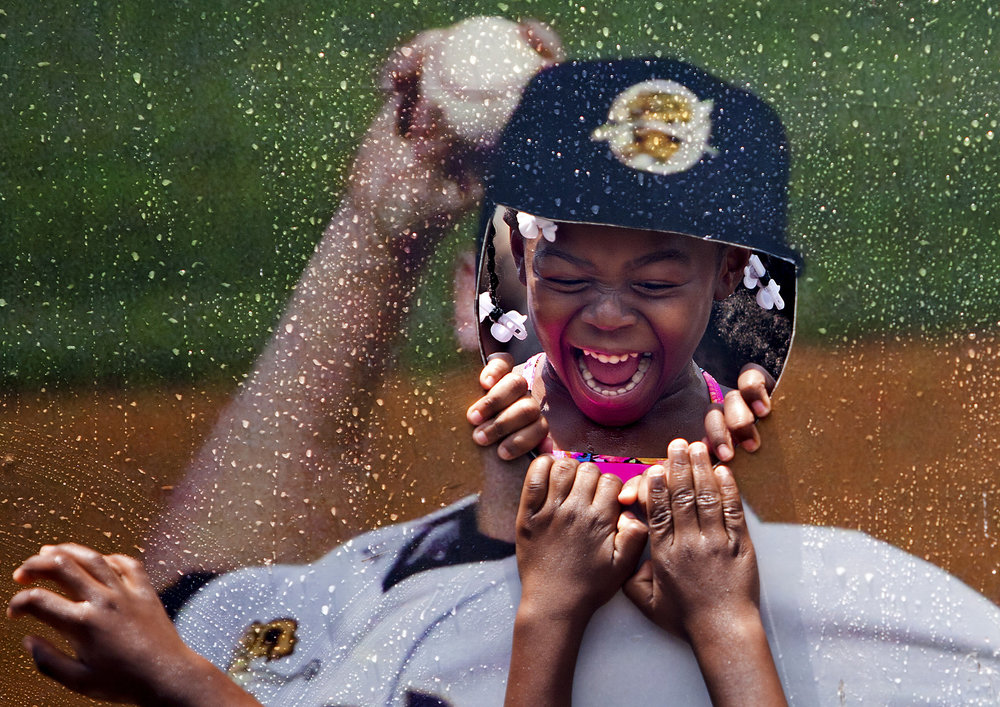Kimani Butcher, 5, of the Toddlers Academy and Preschool in North Charleston, stood in the photo cutout stand at the Charleston RiverDogs Splash Day in Charleston, South Carolina on July 25, 2017.
