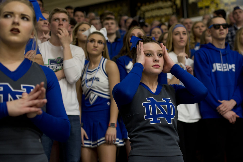 Northeast Dubois' cheerleader Makena Evernan reacted as the Jeeps trailed behind Springs Valley in French Lick on Saturday. The Jeeps lost 68-54.