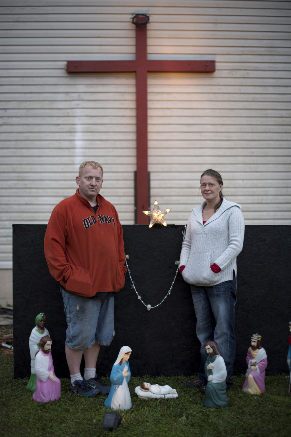 Joseph and Shana Edwards, of Buchtel, Ohio, stand in front of their home by their nativity scene on Nov. 9, 2016. The Edwardses were in the midst of setting up their Christmas lights all over their home.
