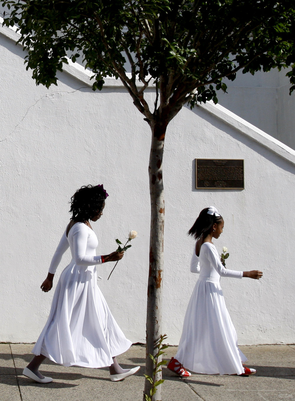 Tyla A. Johnson, left, part of the praise dancer group of the Mother Emanuel AME Church, and Jaelyn Nelson, right, walk towards the steps of the church during the Hate Won't Win Unity Walk in Charleston on Saturday, June 17, 2017, the two-year anniversary of the Mother Emanuel Church shooting. Johnson is the niece of the late Myra Thompson. Nelson is the cousin of the late Tywanza Sanders and the great niece of the late Susie Jackson, who were killed in the shooting.