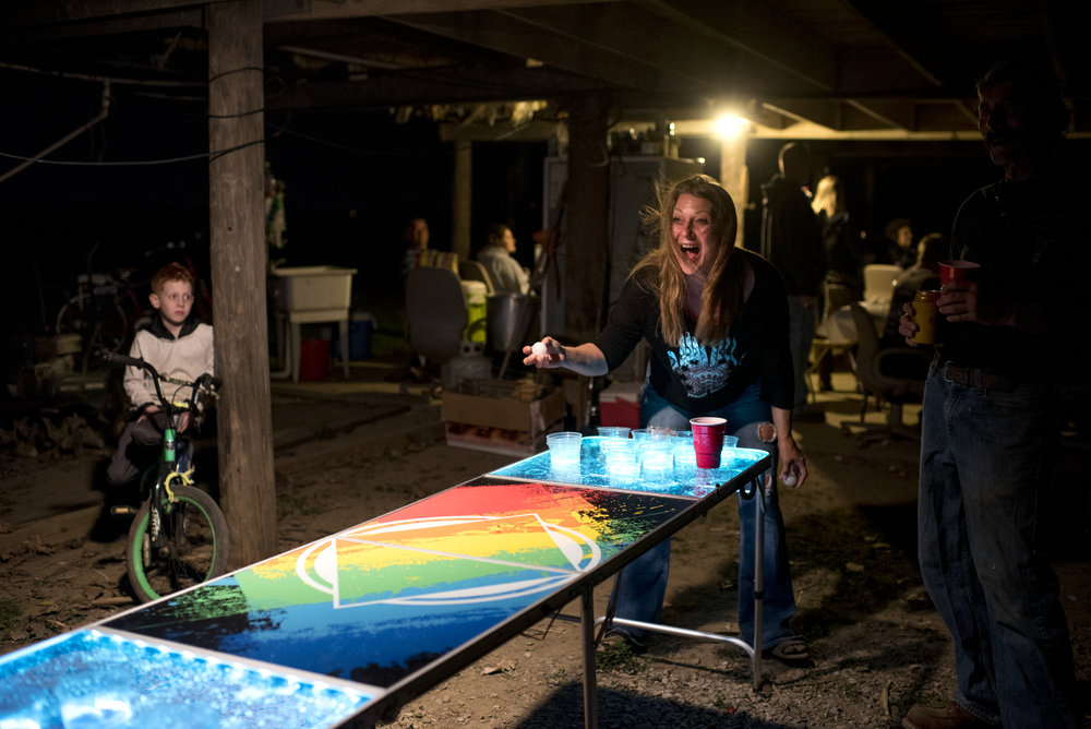 Val Hufford plays beer pong at a birthday party for her friend at the riverbank in Dade, Ky. on Oct. 21, 2017. Parties are frequent at the river, and often birthdays are celebrated communally.