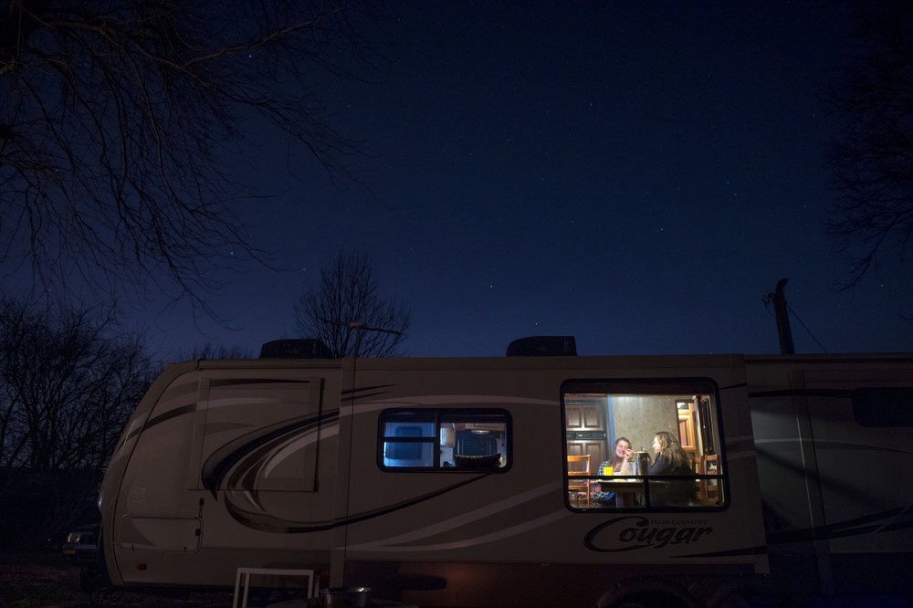 "At the end of the night, Val Hufford and Cathy Cobb-Gish chat in Val's RV on Dec. 9, 2017. Even in the winter months, the self-proclaimed ""River Rats"" love escaping the city and spending time in their camps."