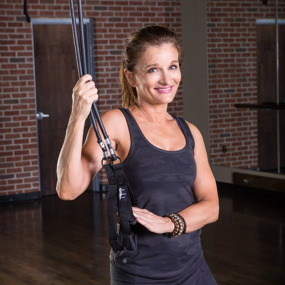 Anchor from the ceiling or upper door strap for a cardio blast and H.I.I.T. workout.