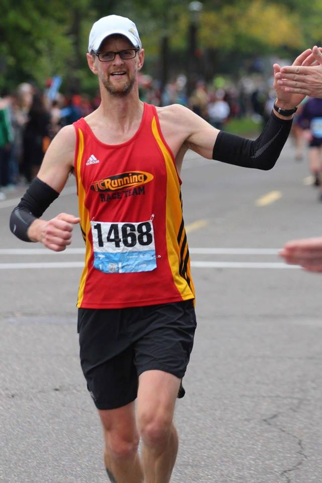 High-fiving at mile 24 - Twin Cities Marathon, 2013