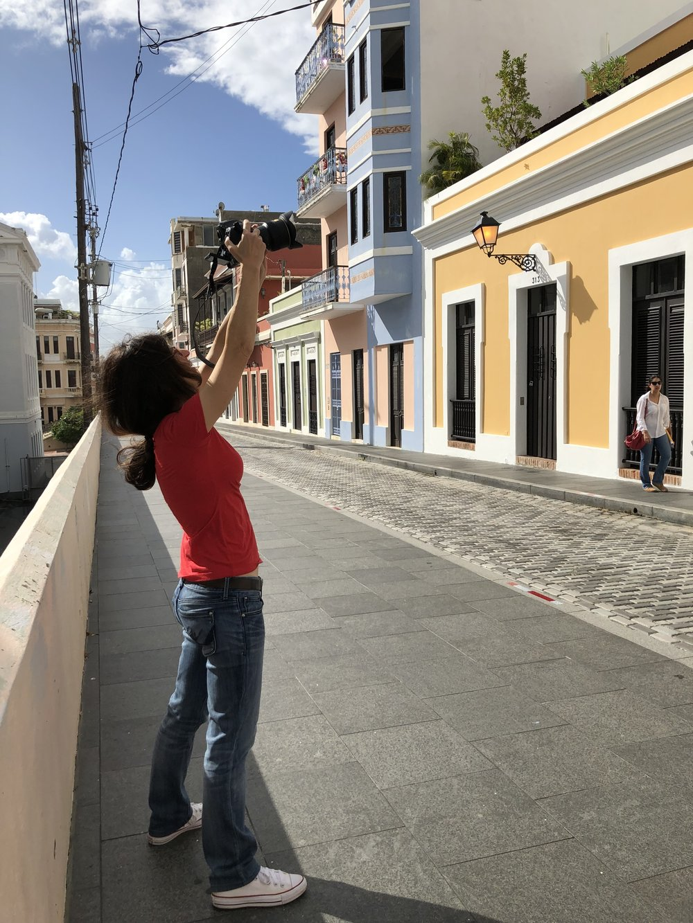 Frances Negrón-Muntaner taking a photo of Rafael Codero's home and school. (Photo: Maggie de la Cuesta)