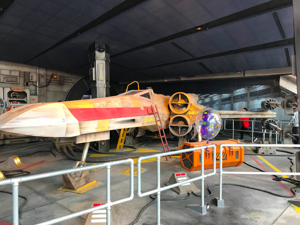 X-wing parked at Space Mountain