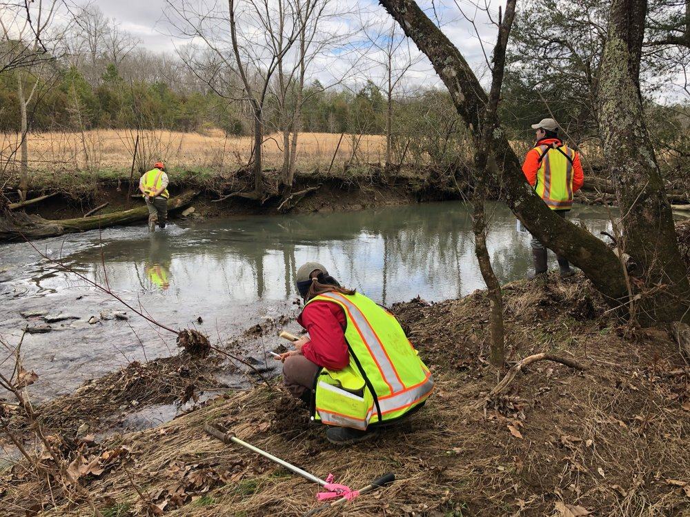 TVA employees along Gunstocker Creek, which is where you cross the private property being condemned on to the Project Viper site.