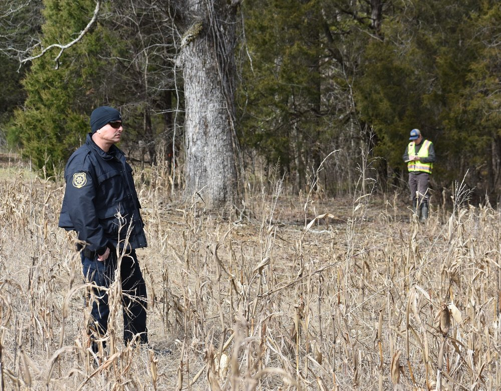 A armed guard escorting TVA employees on Jan 22  onto private farm property.