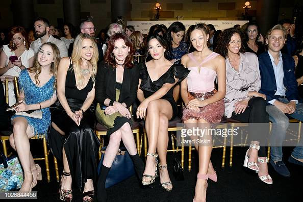 Sitting front row with Marilu Henner, Ana Villafañe (On Your Feet! on Broadway), Ava Cota (Dance Moms), Jeanette Cota, and more celebs [Photo Credit: Getty Images]