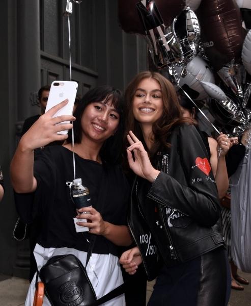 Kaia taking a selfie with a fan