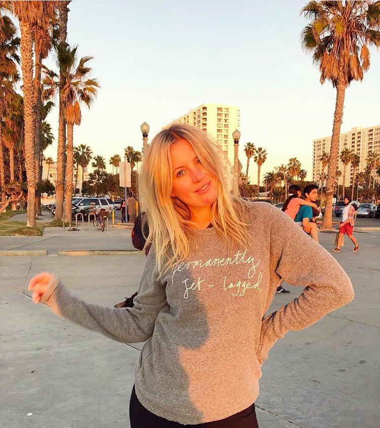 Marissa wearing a Rotten Roach sweatshirt
