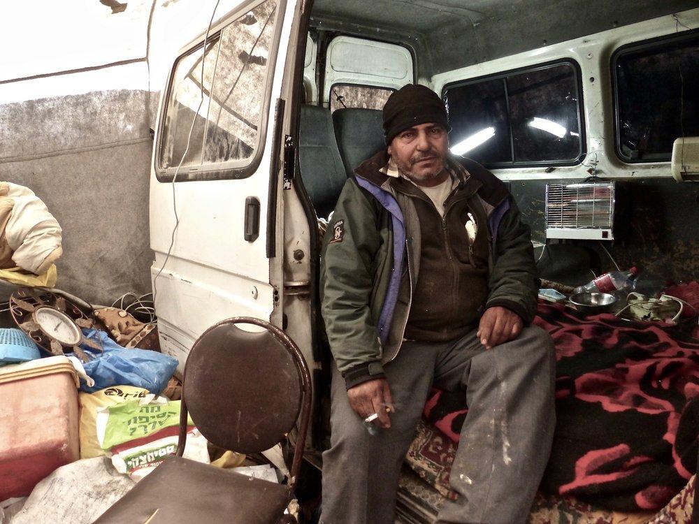 salem in his makeshift house.jpg
