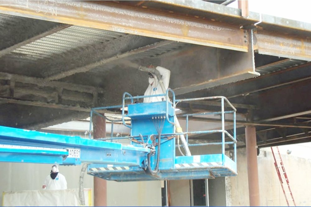 Spray Fireproofing - The application of continuous fiber based spray. Fire proofing is often applied to ceilings, decks and structured beams to achieve the required fire code.