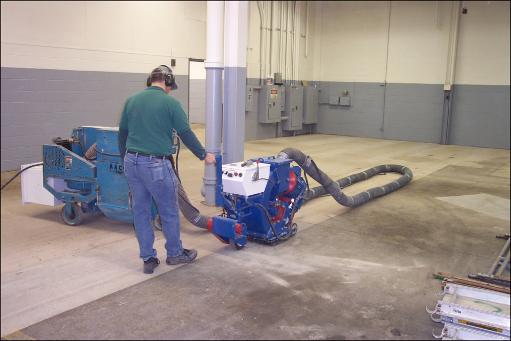 Floor Shot Blasting & Grinding - Abrading a floor by creating a profile that removes a small layer of concrete and/or the top coat. This is commonly used when installing a new floor system to ensure proper adhesive characteristics for the new application.