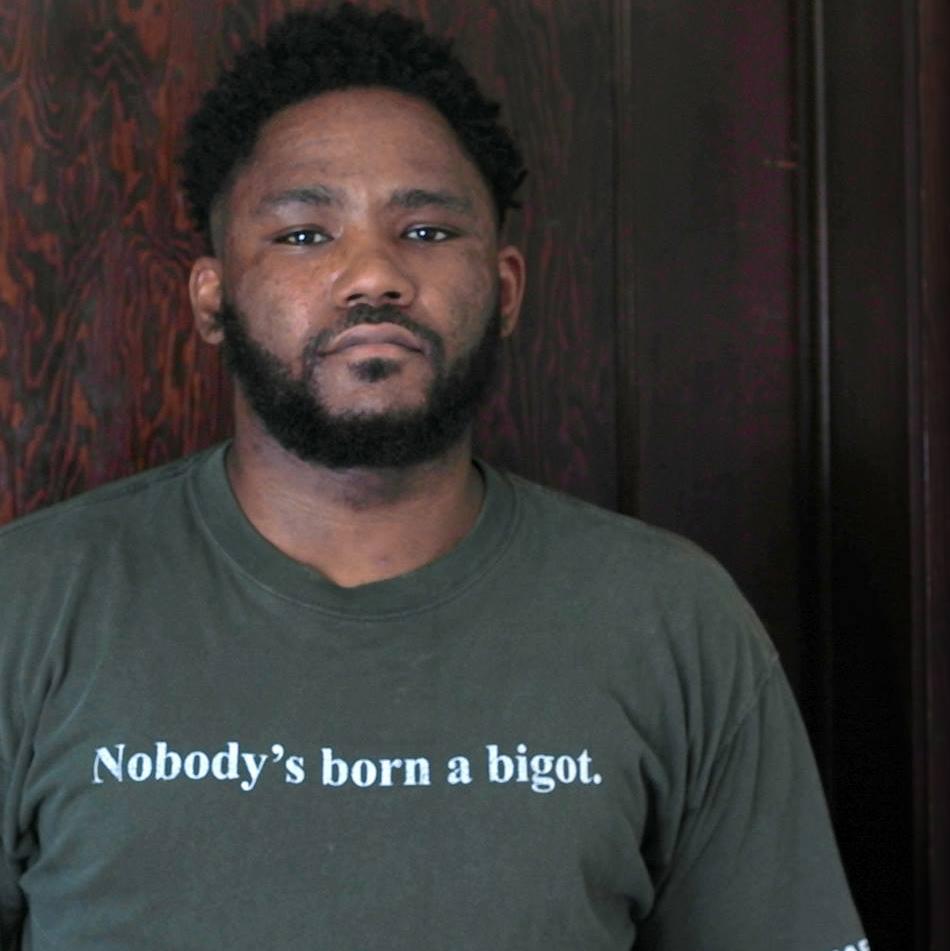 Randy - a young black man with a short beard.