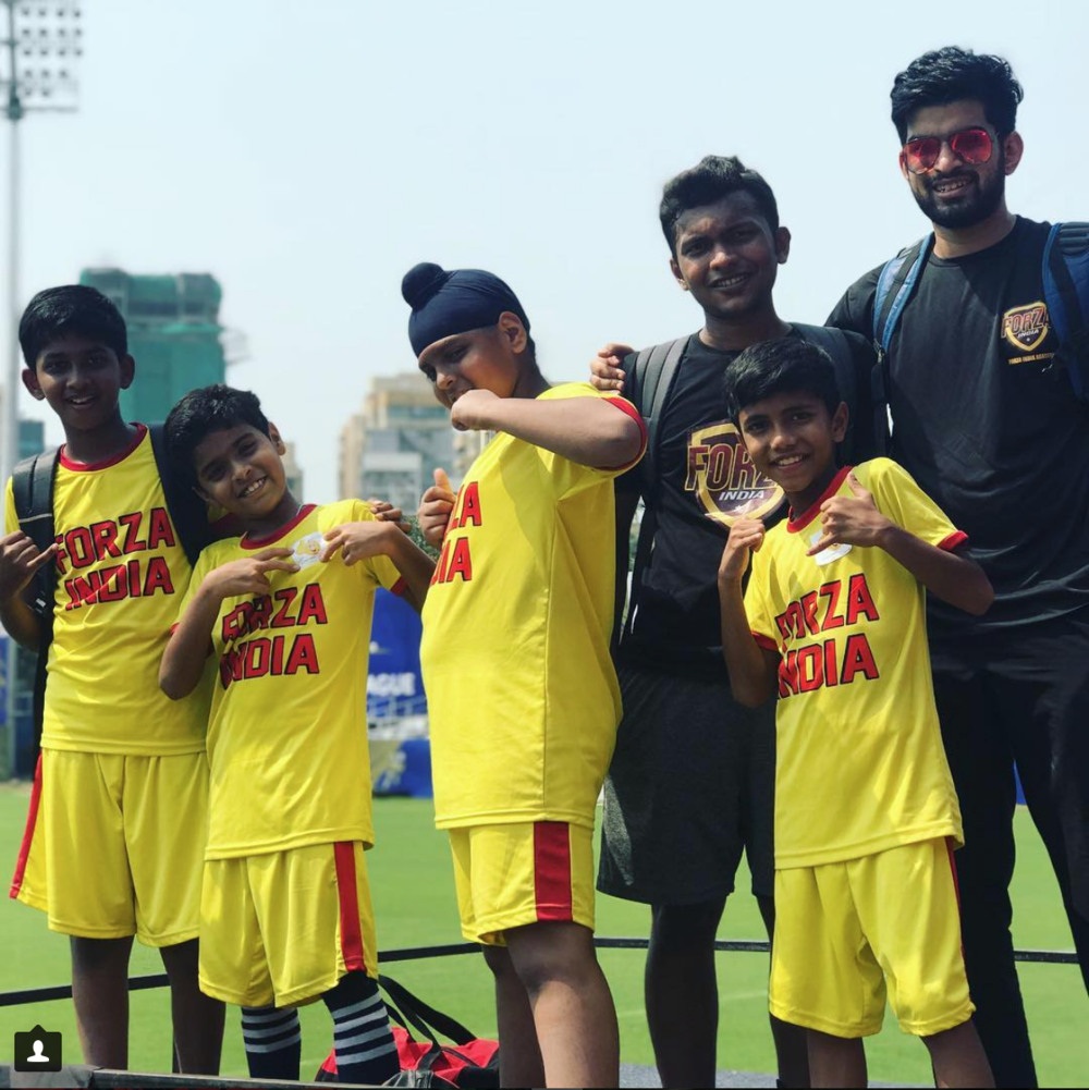 The Forza U13 team in their yellow gear, with their coaches Lay and Vipul.