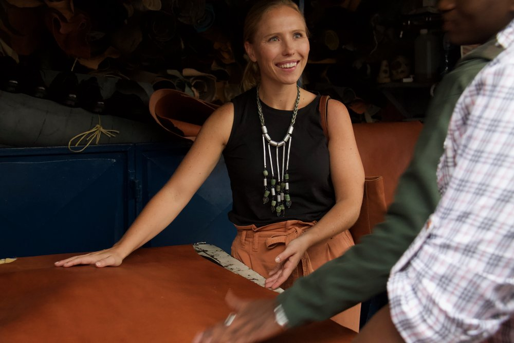 Abby, the founder, working with our leather source in Nairobi to choose leather.