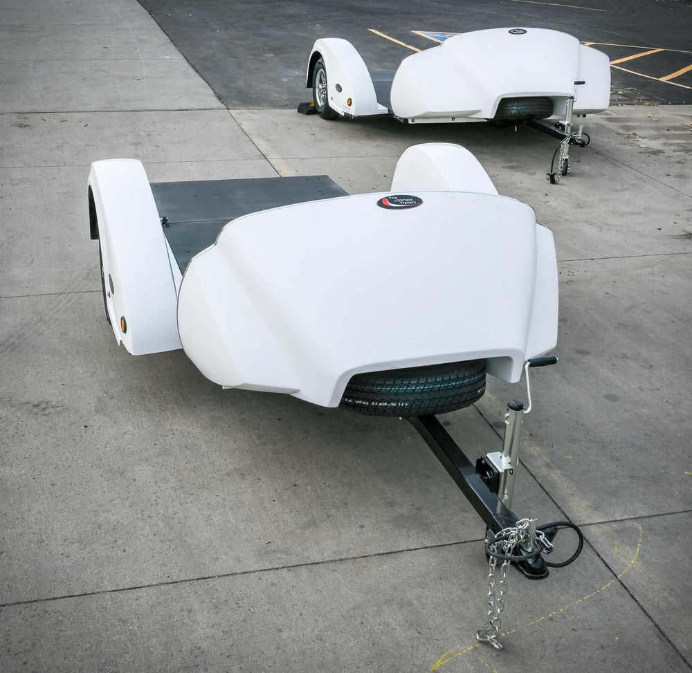 New generation of air-lowering trailers. OHT1 and OHT3 designs shown.