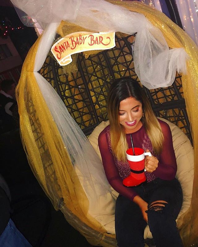"Get a head start on your resolutions by getting on Santa's ""nice"" list before he heads back to the North Pole 😉 Admission is free tonight! #santababybar 📸: @siobs_walsh"