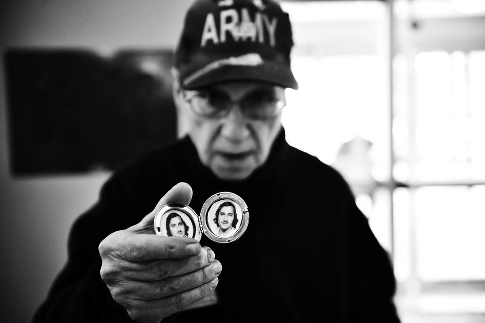 Vietnam veteran Nicholas Borowitz, 69, holds up a photo of himself when he was young in Wilkes-Barre, Pa.
