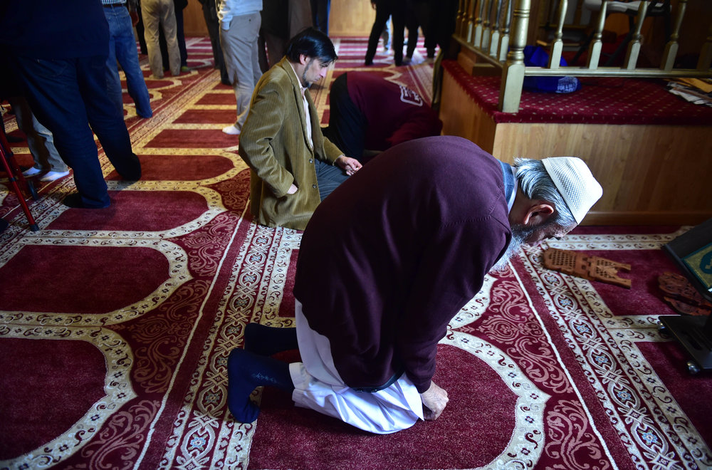 Jameel Ahmed, 81, originally from Kirachi, Pakistan, kneels to pray after the formal service in the Masjid Al-Noor mosque in Wilkes-Barre, Pa. Many local Muslims immigrated to Northeast Pennsylvania to escape political strife and conflict in their home countries and to seek a better life.