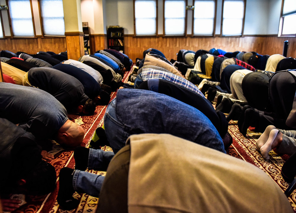 Men pray during service at Masjid Al-Noor.