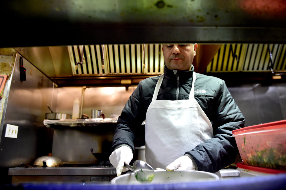 "Sudqi Barqawi, 50,  prepares salad at Jerusalem Halal Market in Wilkes-Barre, Pa.  Palestinian-born Barqawi has owned the restaurant for 14 years and said, ""The dream of the people comes true in America."""