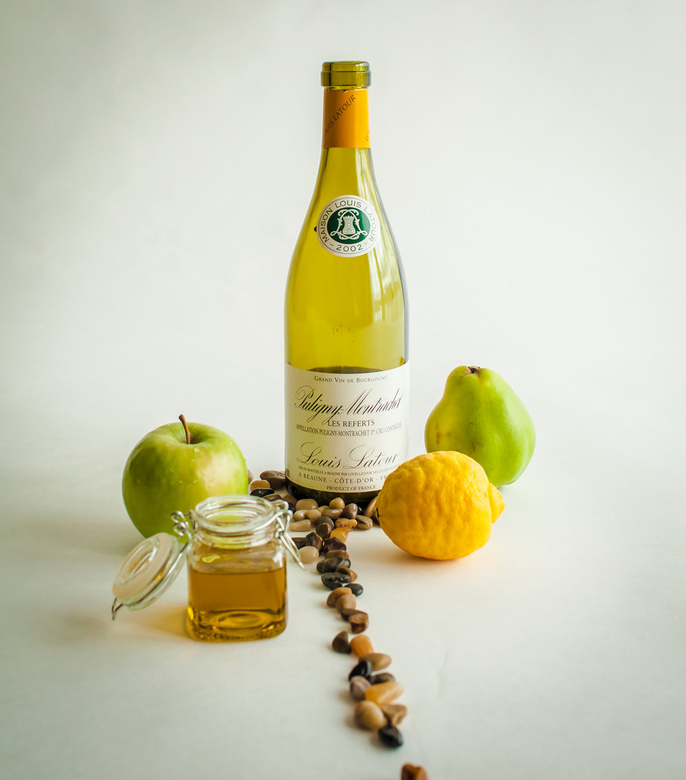 For example, this 2002 Puligny - Montrachet swirls with attractively youthful citrus tones (in the photo: green apple, lemon, lime) on the nose and a creaminess (olive oil) on the palate, with wave after wave of mineral aromas (PEBBLES) continuing through. This photo tasting note gives the audience a brief ILLUSTRATION of how the wine smells and tastes like.